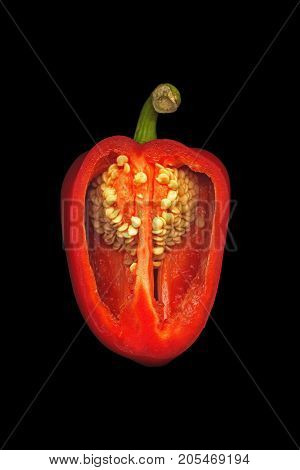 Sweet red capsicum in a section on a black background