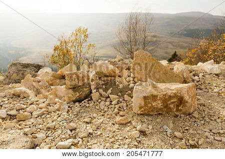 trekking, sport life, health concept. on the edge of mountain there are lots of lumps and small stones of creamy white colour, they are covered all surface of mountain sides