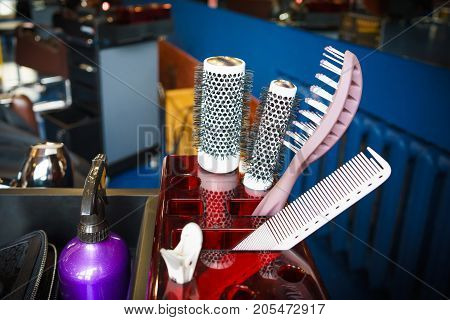 Hairdresser set with various accessories in box on the table