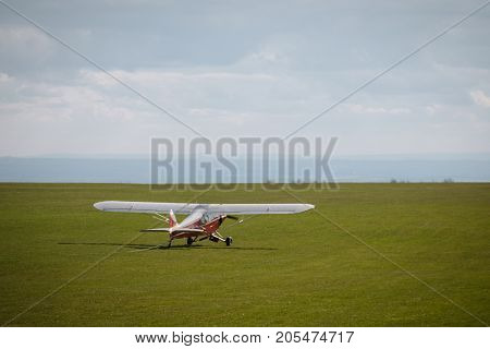 Small Propeller Airplane Private Towing Aircraft On The Contryside Field England