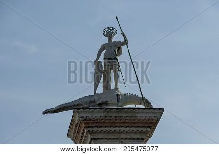 Venice, Italy - September 23, 2011: Statue of St. Theodore on column in the piazza San Marco, Venezia, Venice, Italy, Europe . Visit in place.