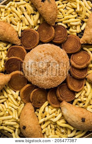 stock photo of Indian festival or diwali food called Bakarvadi , aloo sev bhujiya and karanji or Gujiya, selective focus