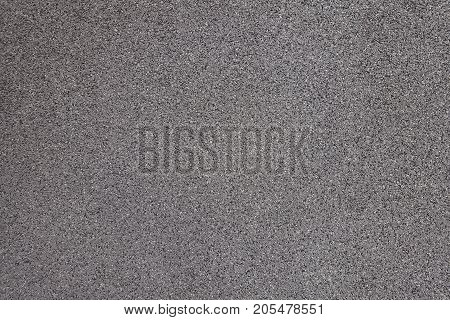 Grey Exterior Wall With Pebbledash From The Side