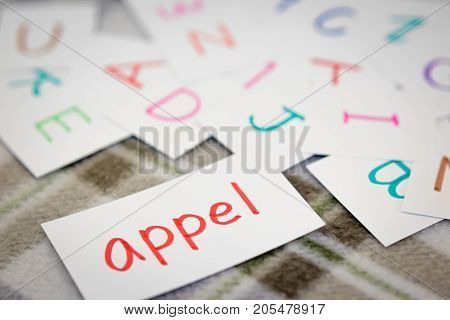 Dutch; Learning The New Word With The Alphabet Cards; Writing Apple