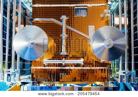 Space satellite spaceship with shiny panels close up