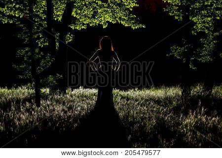 Scene of a dark silhouette with light painting for halloween