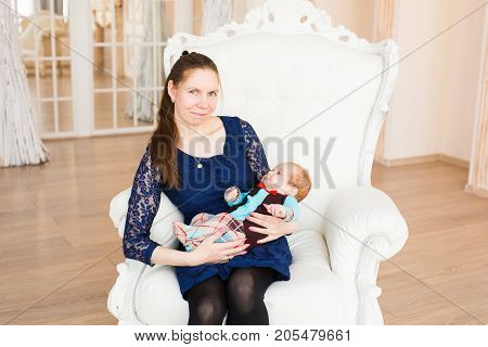 Portrait of a cute baby boy with his mother. Adorable three month old child
