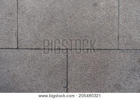 Closeup Of Pavement Made Of Grey Granite Blocks