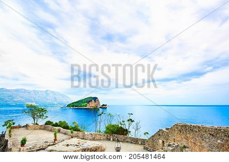 Seascape with desert island in blue heavens. View of sea landscape from walls of medieval fortress.