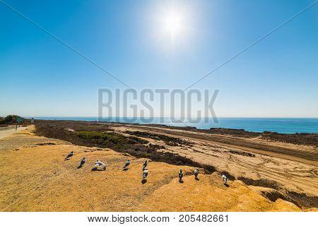 Sun shining over California coastline in USA