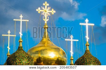 Christian church in the sun, crosses on golden domes