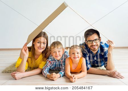 A portrait of a happy family moving into a new house