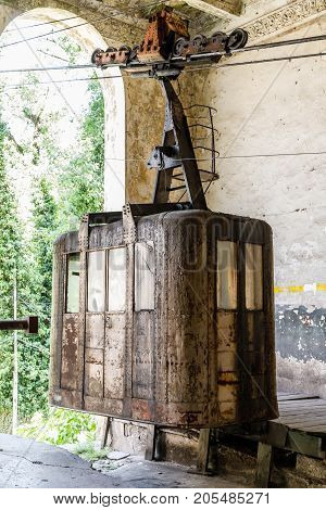 Old soviet rusty and functioning ropeway or cable car cabins in Chiatura, Georgia