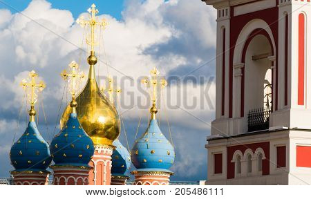 Christian church in the sun and a crane , moscow