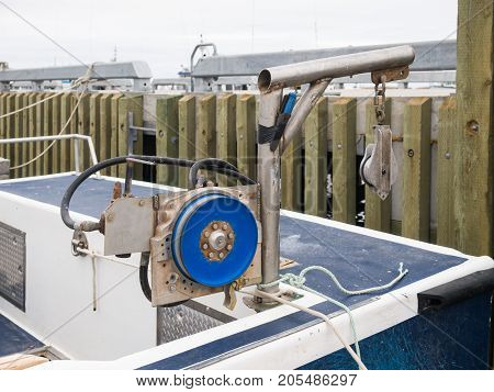 Fishing blue pulley gear at rear of the boat