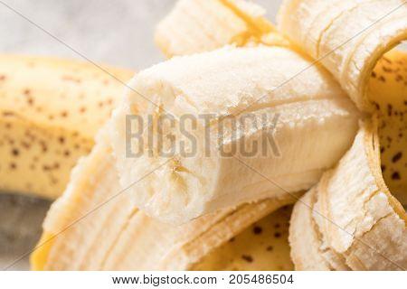 Close up shot of a fresh ripe banana is peeled.