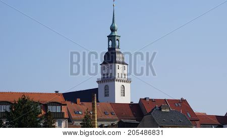 A steeple over the roofs of a small Saxon town in Germany