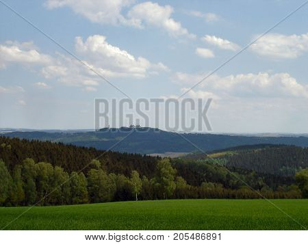 the Erzgebirge in spring; view to the Augustusburg castle, mountains and valleys, hilly landscape in Saxony, Germany
