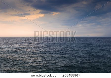 Calm seawater after storm under bright blue sky