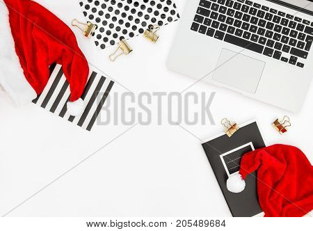 Office Workplace with Keyboard Laptop Computer and Christmas Decoration. Business Holidays Concept