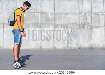 Full length side view orderly teenager going on gyroscope. Copy space
