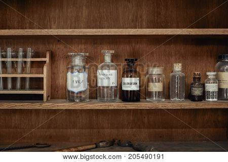 Old Science workbench made out of wood with chemical components