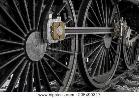 Wheels of an old locomotive closeup photo