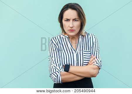 Angry, Aggressive. Handsome Adult Elegant Woman Looking At Camera With Angry Face.
