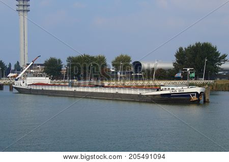 Lelystad, The Netherlands - September 24, 2017: Inland waterway motor freighter Laus Deo lying in the harbor of Lelystad.