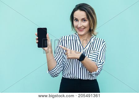 Technologies Concept. Cute Blonde Business Woman Pointing Finger To New Smart Phone And Looking At C