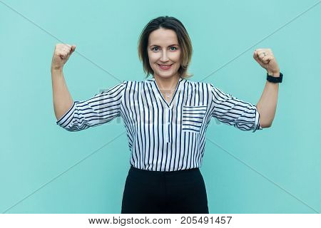 Beautiful Business Woman Posing Looks Like Bodybuilder, Showing Biceps, Looking At Camera And Toothy