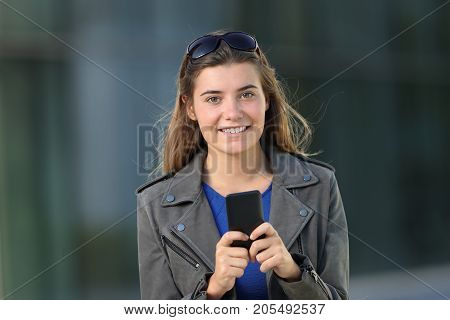 Fashion Girl Using A Phone And Looking At You