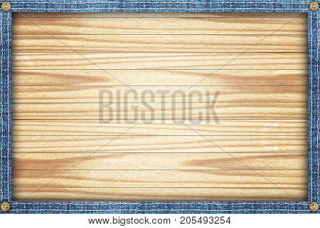Wooden background framed in a denim frame