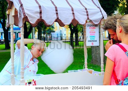Chernihiv / Ukraine. 20 August 2017:The girl works as a seller of sweet cotton wool in the city park. 20 August 2017 in Chernihiv / Ukraine.
