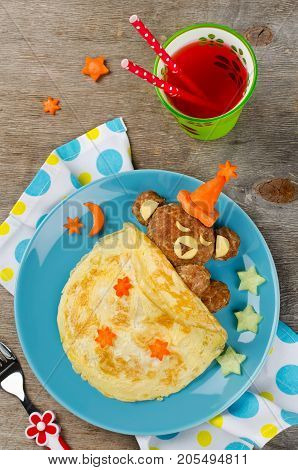 Sleeping bear made of meatball covered with blanket made of omelet (omelette). Creative idea for kids food