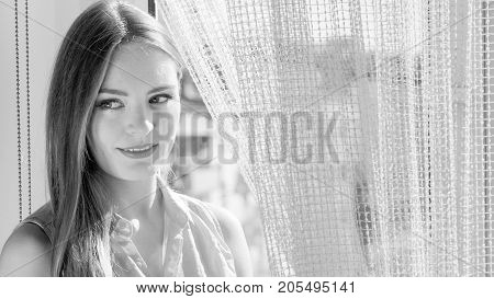 Woman Looking Through Window, Relaxing