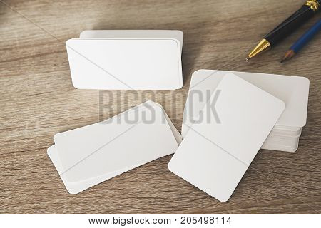 Blank corporate identity business card package on worker table for design mockup