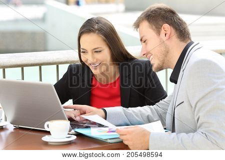 Two Executives Working On Line In A Bar