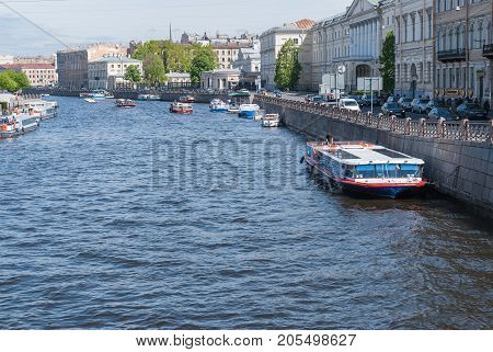 ST PETERSBURG RUSSIA - MAY 28 2017: Pleasure boats and sightseeing boats on the Fontanka River.