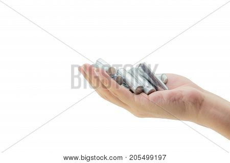 recycle - energy - power - environment and ecology concept - close up of hand holding alkaline batteries heap - clipping part.