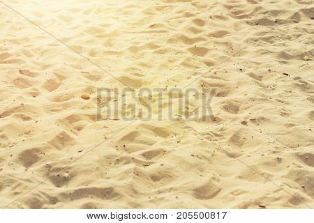 closeup of sand of a beach in the sunlight