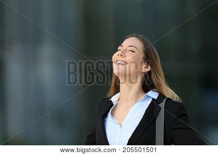 Happy Successful Executive Breathing On The Street