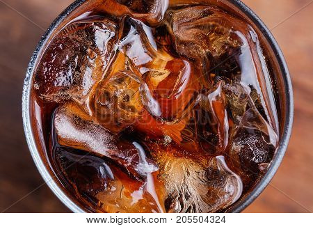 Cola With Ice Cubes In Glass Top View Isolated On Wooden Background, Clipping Path Included