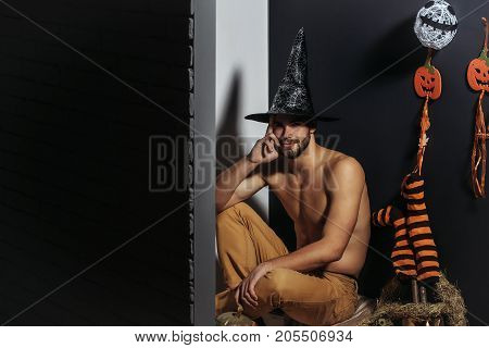 Halloween Man Smiling In Witch Hat And Bared Torso