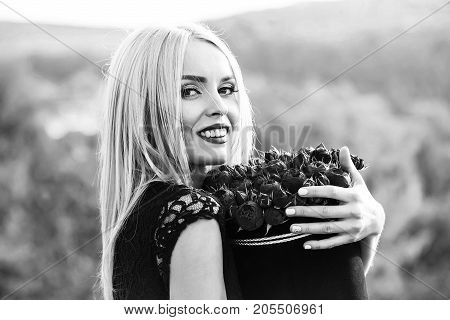 Woman With Flowers In Box