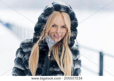 Girl Smiling With Long Blond Hair On Winter Day