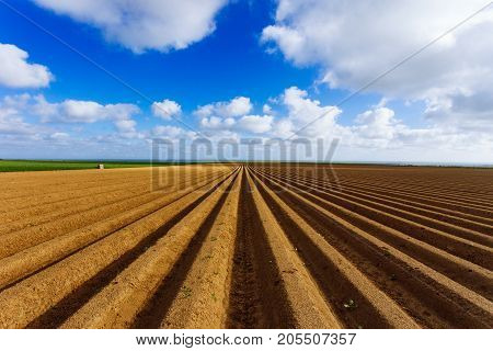 Plowed Agricultural Fields Prepared For Planting Crops In Normandy, France. Countryside Landscape Wi