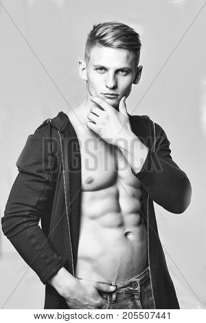 Handsome man young with muscular sexy torso pose with open shirt on grey background