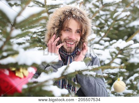 Happy Macho With Bearded Face In Snow Forest