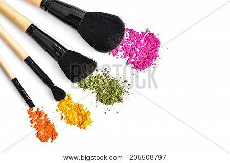 Makeup Brushes And Crushed Eyeshadow